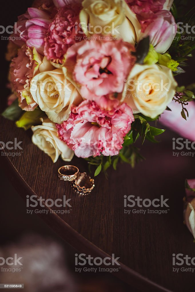 Wedding bouquet and wedding rings royalty-free stock photo