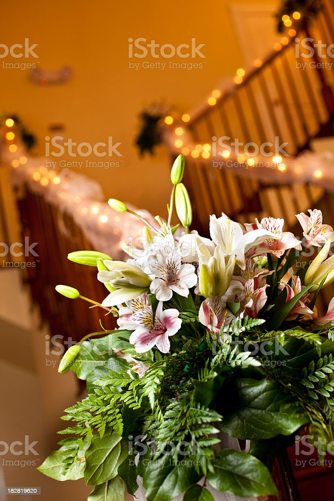 Wedding bouquet at end of decorated staircase. royalty-free stock photo
