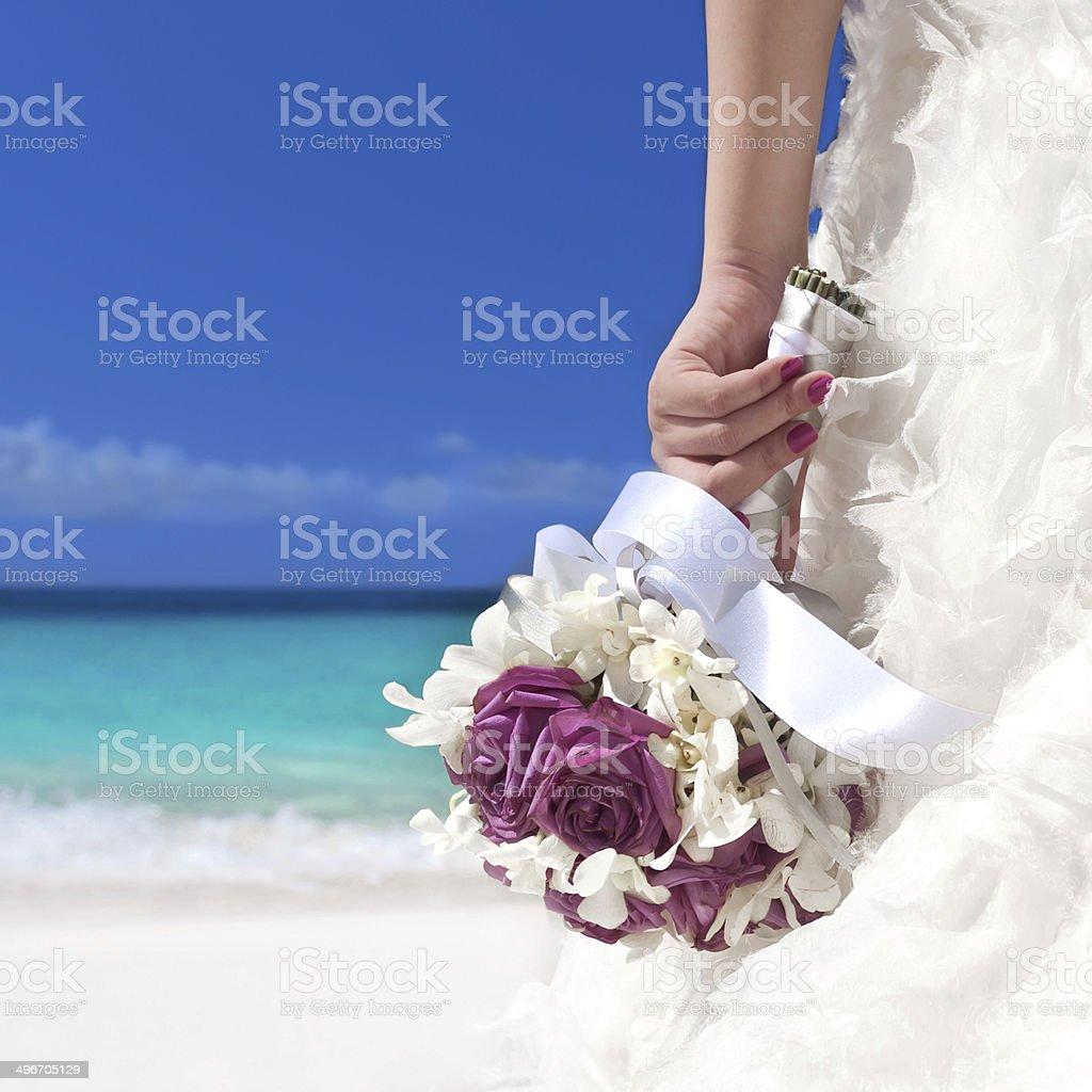 Wedding bouquet in bride's hand stock photo