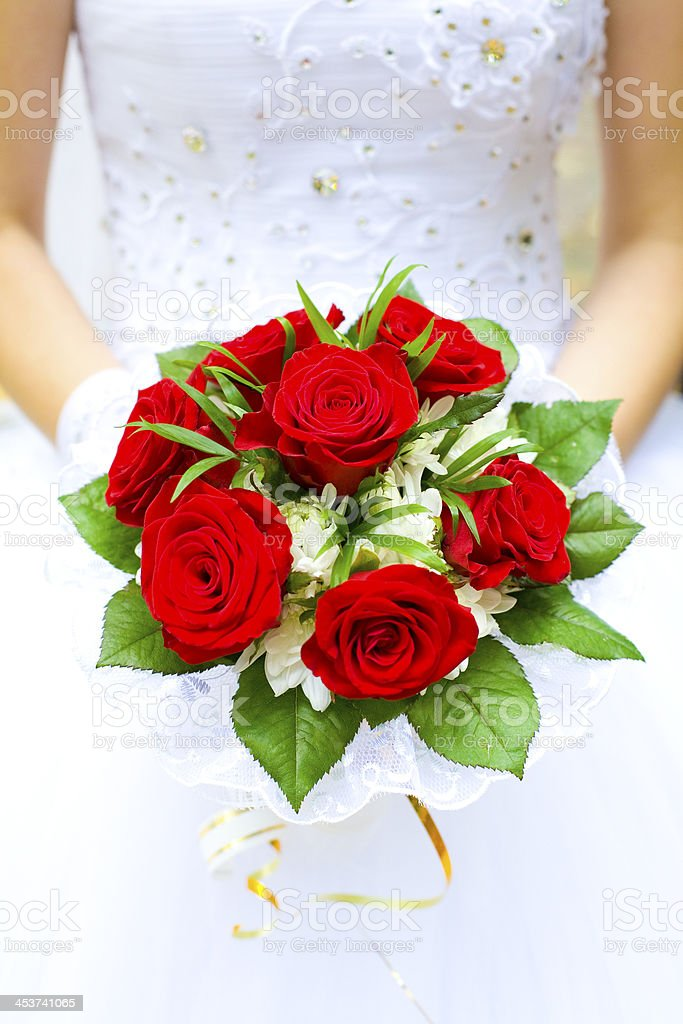Wedding bouquet in hands of the bride royalty-free stock photo