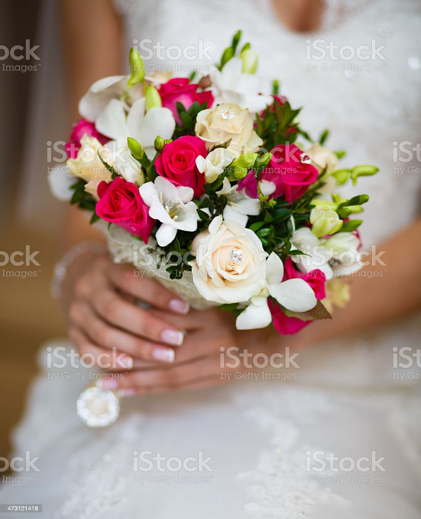 Wedding bouquet in the hands of bride stock photo