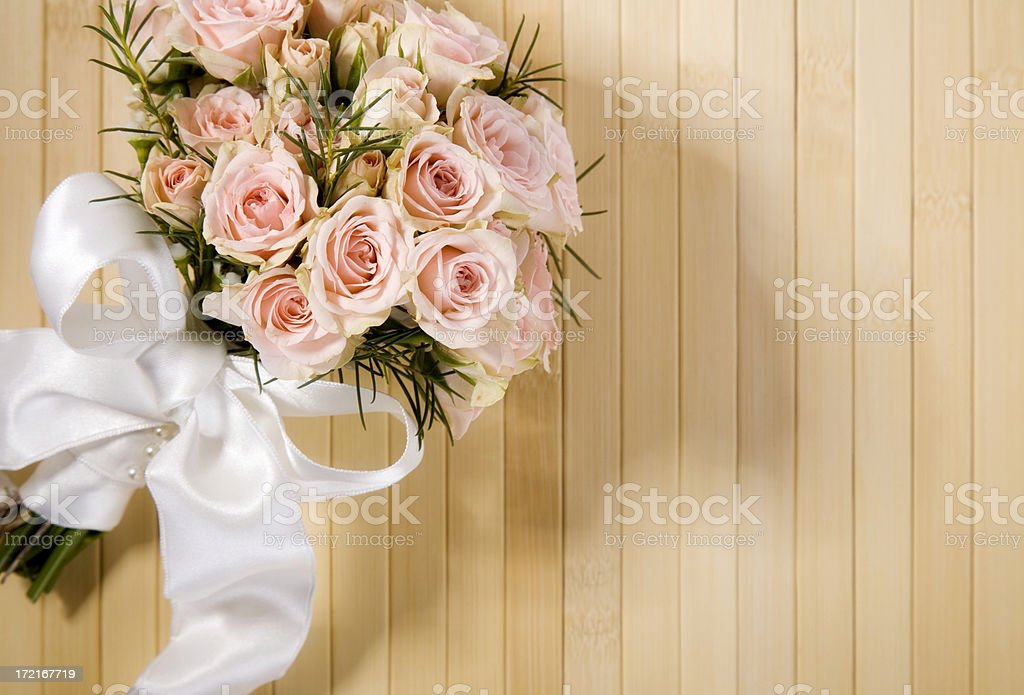 Wedding Bouquet Laying on Bamboo royalty-free stock photo