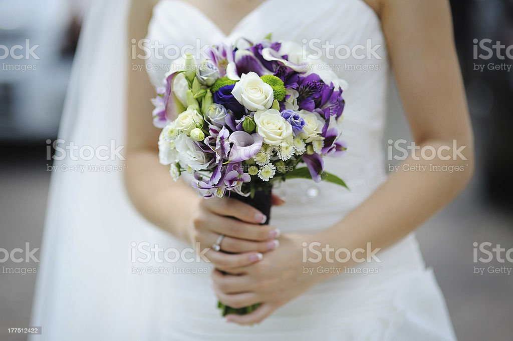 wedding bouquet of purple and white flowers stock photo