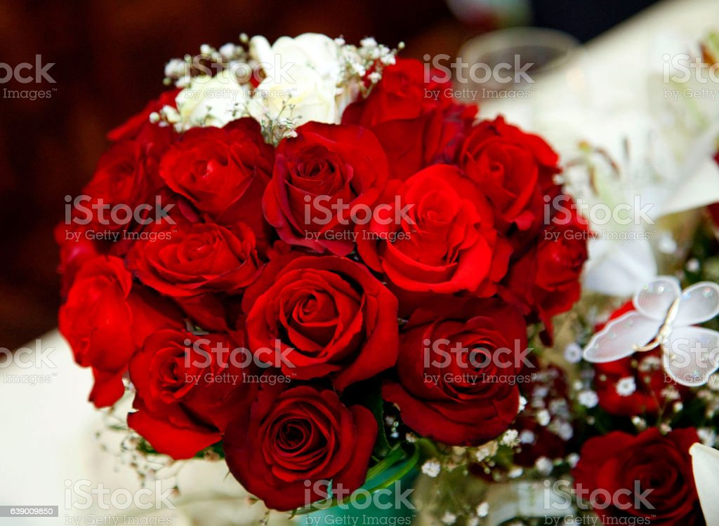 wedding bouquet of red roses stock photo