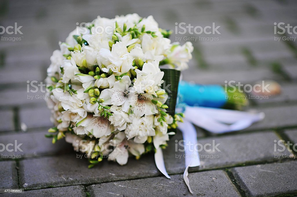 Wedding bouquet on the pavement stock photo