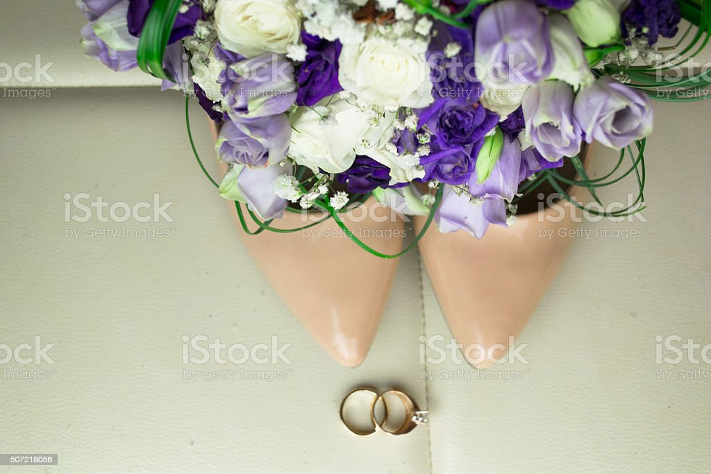 Wedding bouquet with blue flowers and bride shoes stock photo