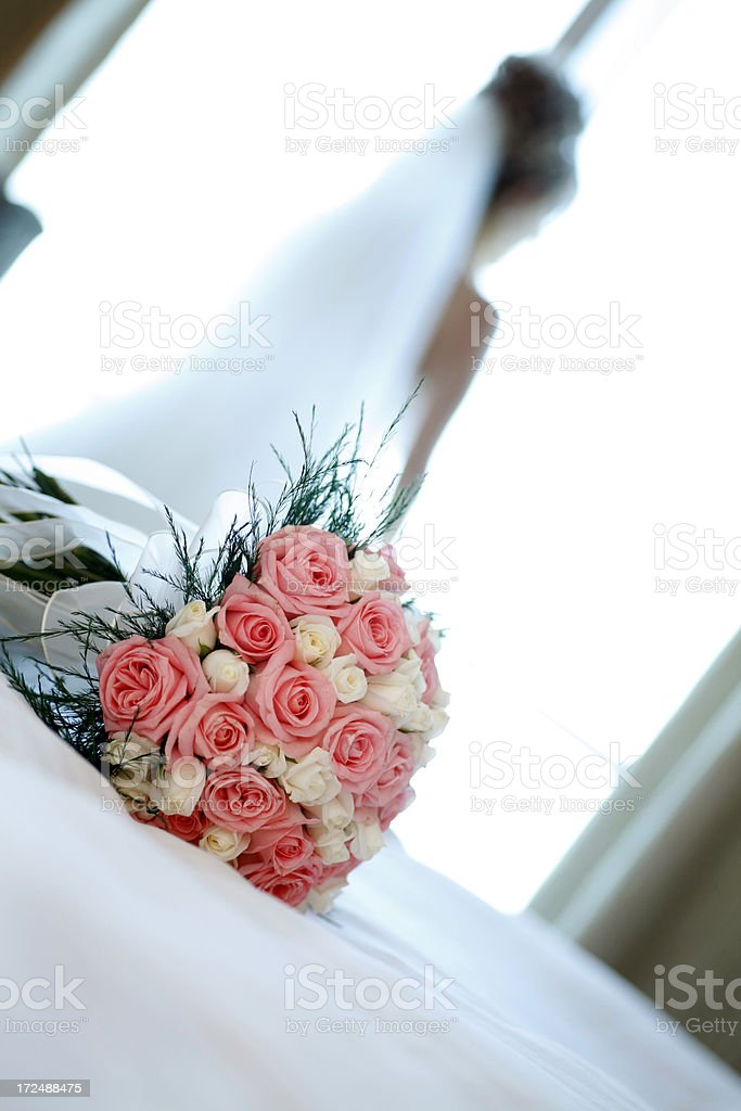 wedding bouquet with bride in the out of focus background. royalty-free stock photo