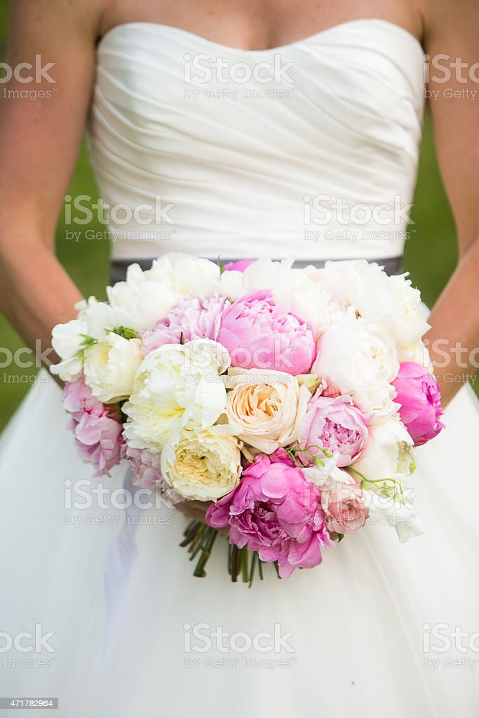 Wedding bouquet with Peonies, garden Roses, and Sweet pea, flowers stock photo