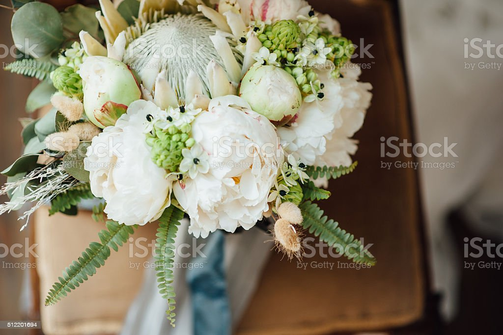 wedding bouquet with peonies standing on a window stock photo