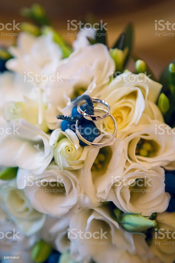 wedding bouquet with white roses and lying stock photo