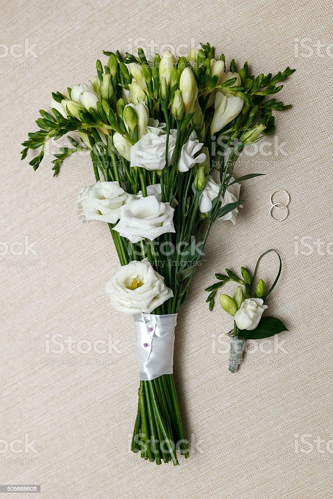 wedding Bridal bouquet and boutonniere for the groom and ring. stock photo