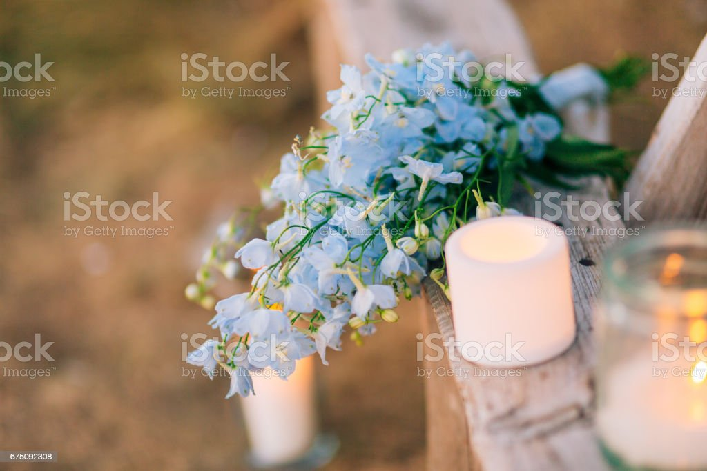 Wedding bridal bouquet of blue Delphinium on an old wooden bench stock photo