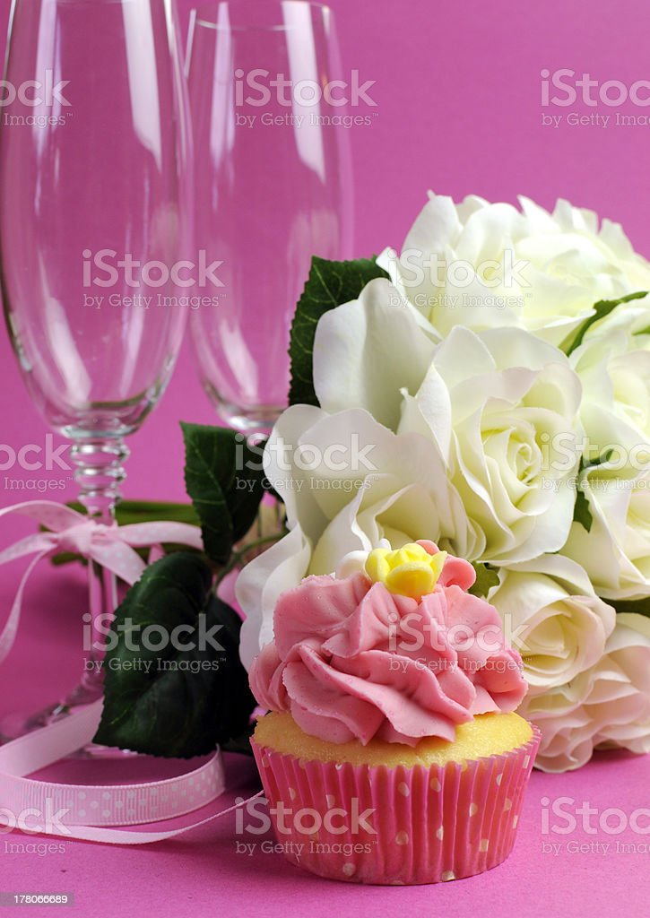 Wedding bridal bouquet of white roses with pink cupcake royalty-free stock photo