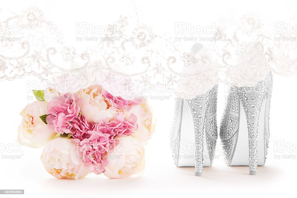 Wedding bridal fashion shoes with the lace veil. stock photo
