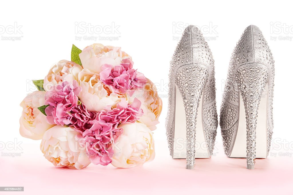 Wedding bridal fashion shoes.bouquet and brilliant silver shoes stock photo