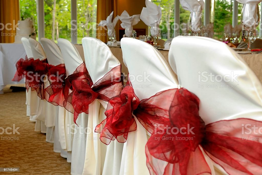 Wedding, Bridal Table and Decorated chairs with red ribbon royalty-free stock photo