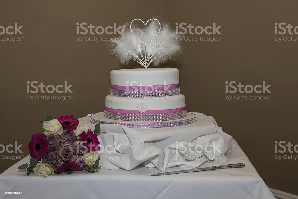 wedding cake and bouquet royalty-free stock photo