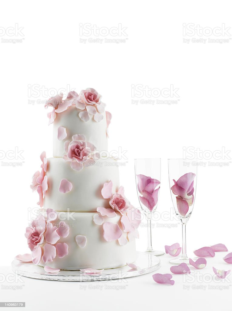 Wedding Cake and champagne flute glasses On White Background stock photo