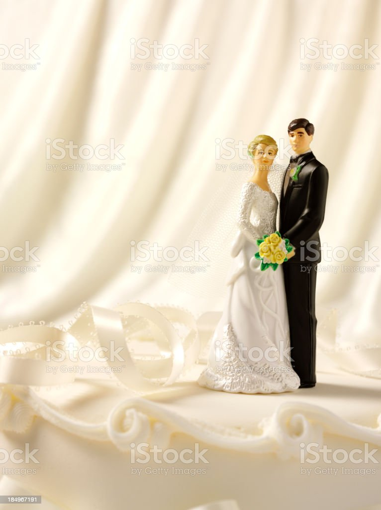 Wedding Cake and Figurines stock photo