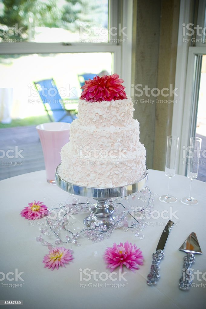 Wedding Cake and Utensils on Table royalty-free stock photo