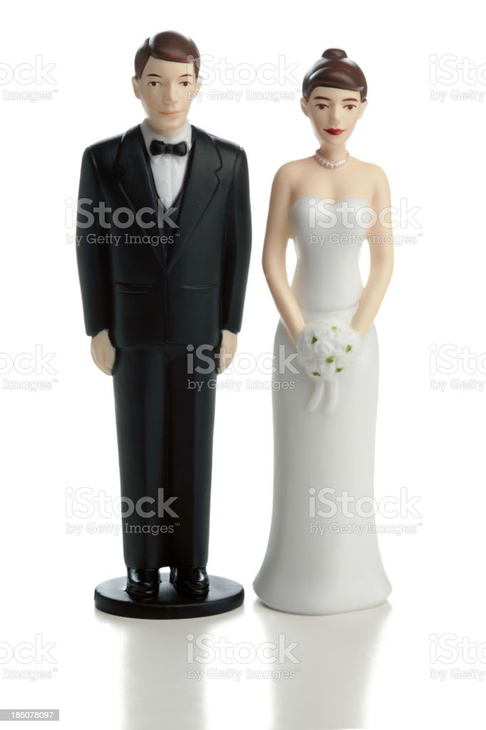 Wedding cake bride and groom statuettes on white stock photo