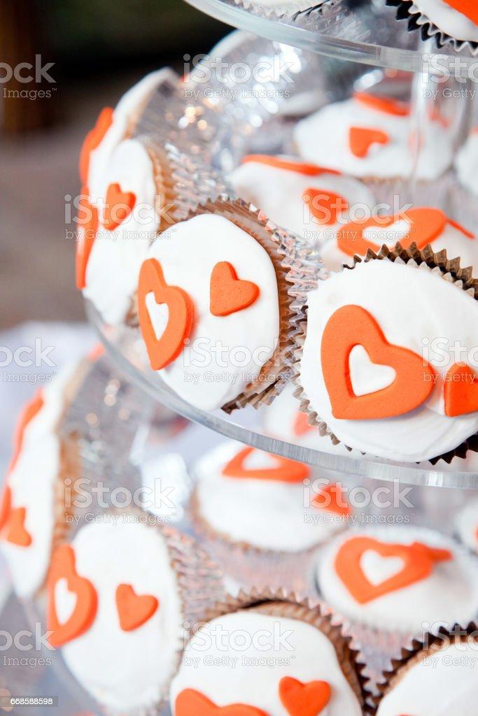 Wedding Cake Cupcake Tower Orange Hearts stock photo