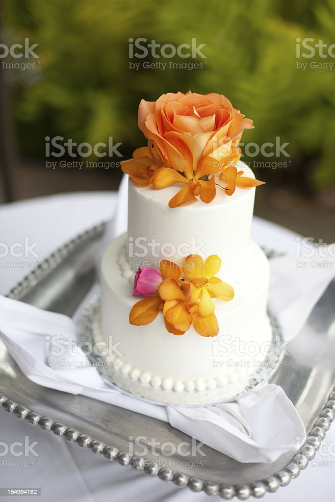 Wedding cake decorated with flowers royalty-free stock photo