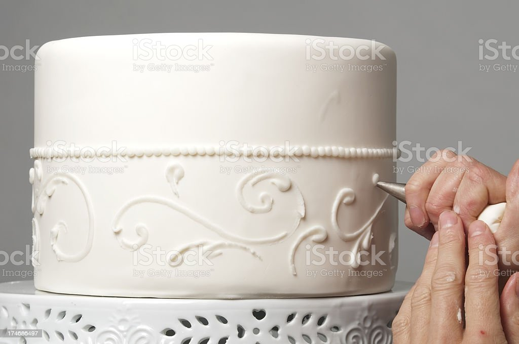 Wedding cake decorating stock photo