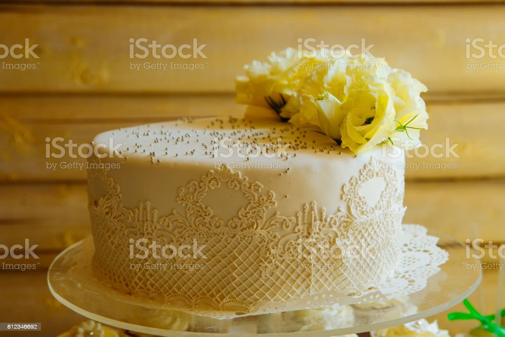 Wedding cake on a stand. Wedding preparations. Wedding Attributes stock photo