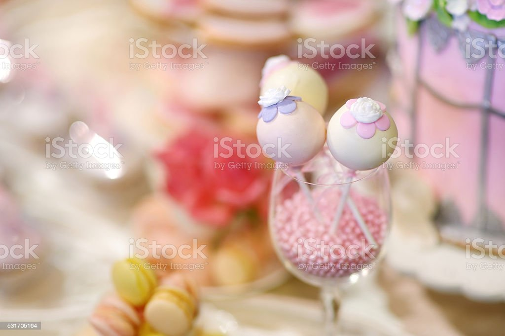 Wedding cake pops decorated with sugar flowers stock photo