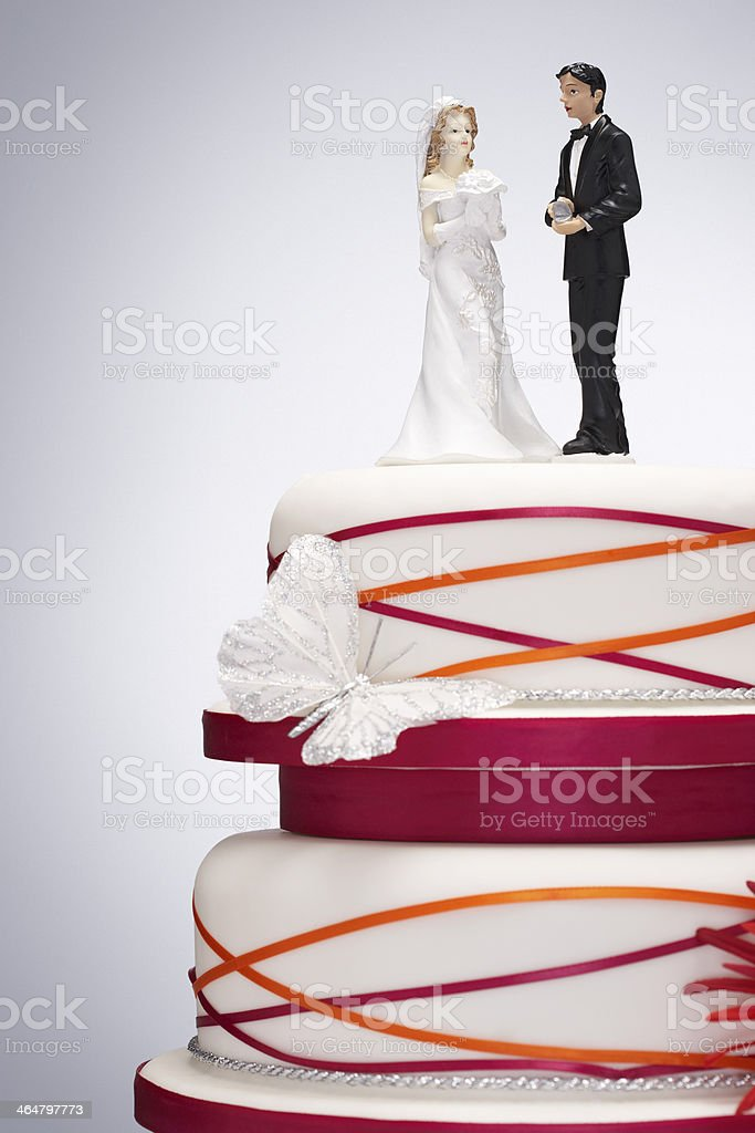 Wedding Cake with Bride and Groom Figurines stock photo