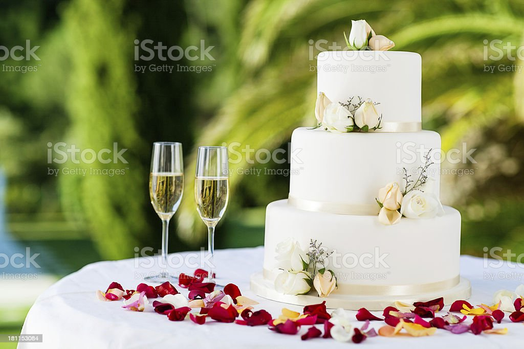 Wedding Cake With Champagne Flutes On Table stock photo