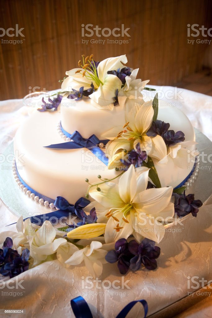 Wedding Cake with Flower and Ribbon Decoration stock photo