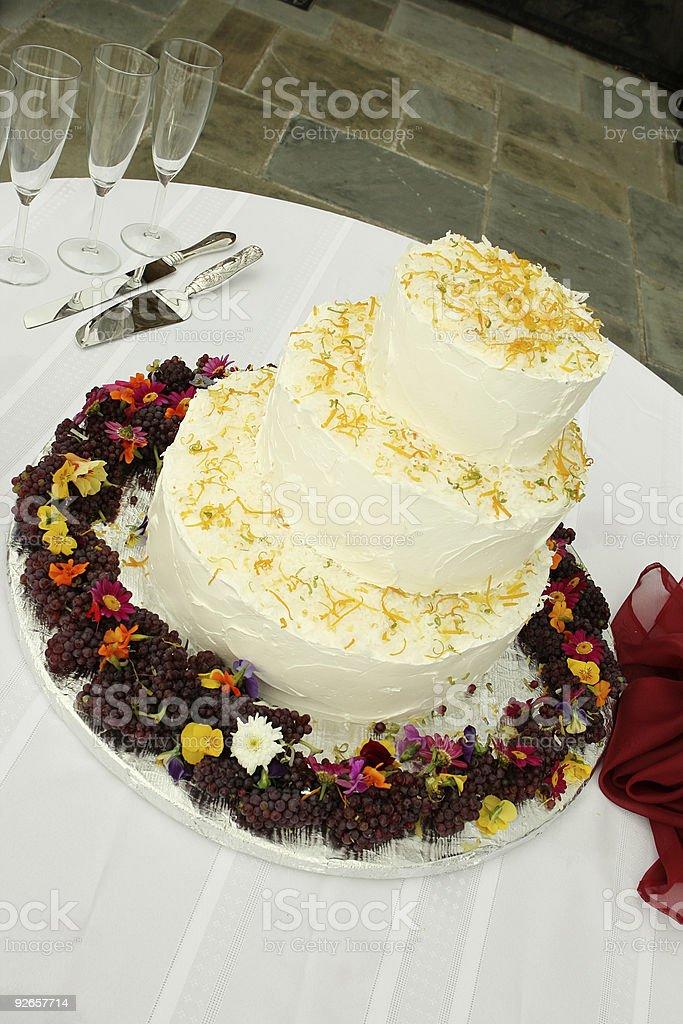Wedding Cake with Flowers Surrounding it royalty-free stock photo