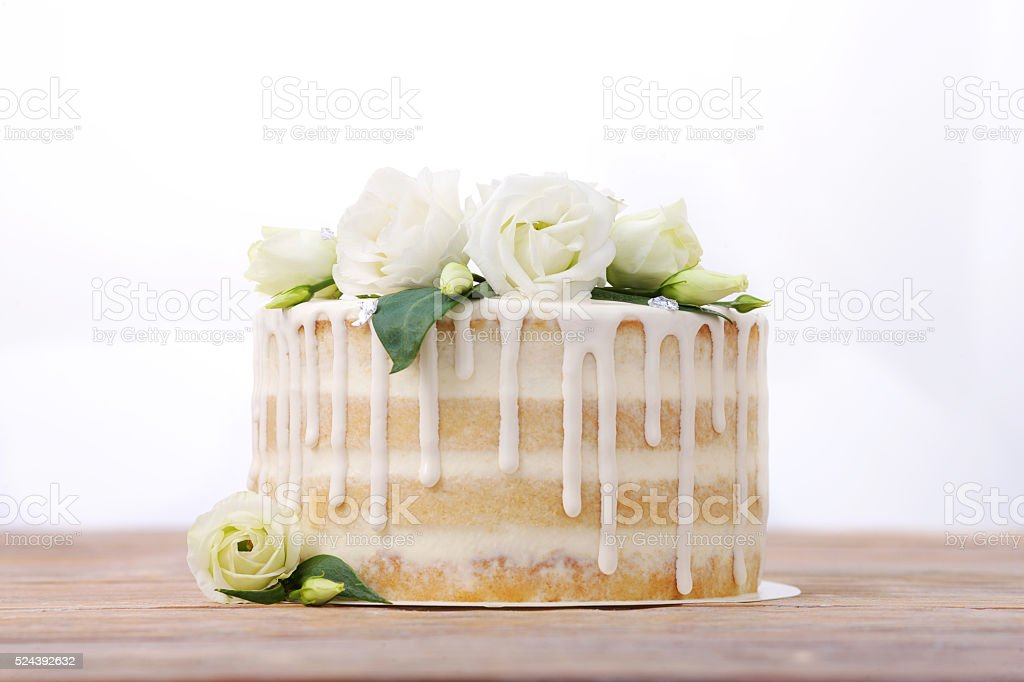 Wedding cake with glaze an eadible silver and flowers stock photo