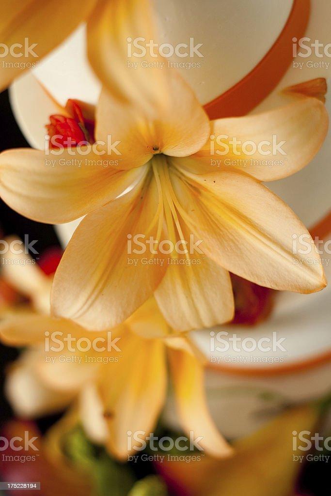 Wedding Cake with Orange Lily Flower Decoration stock photo