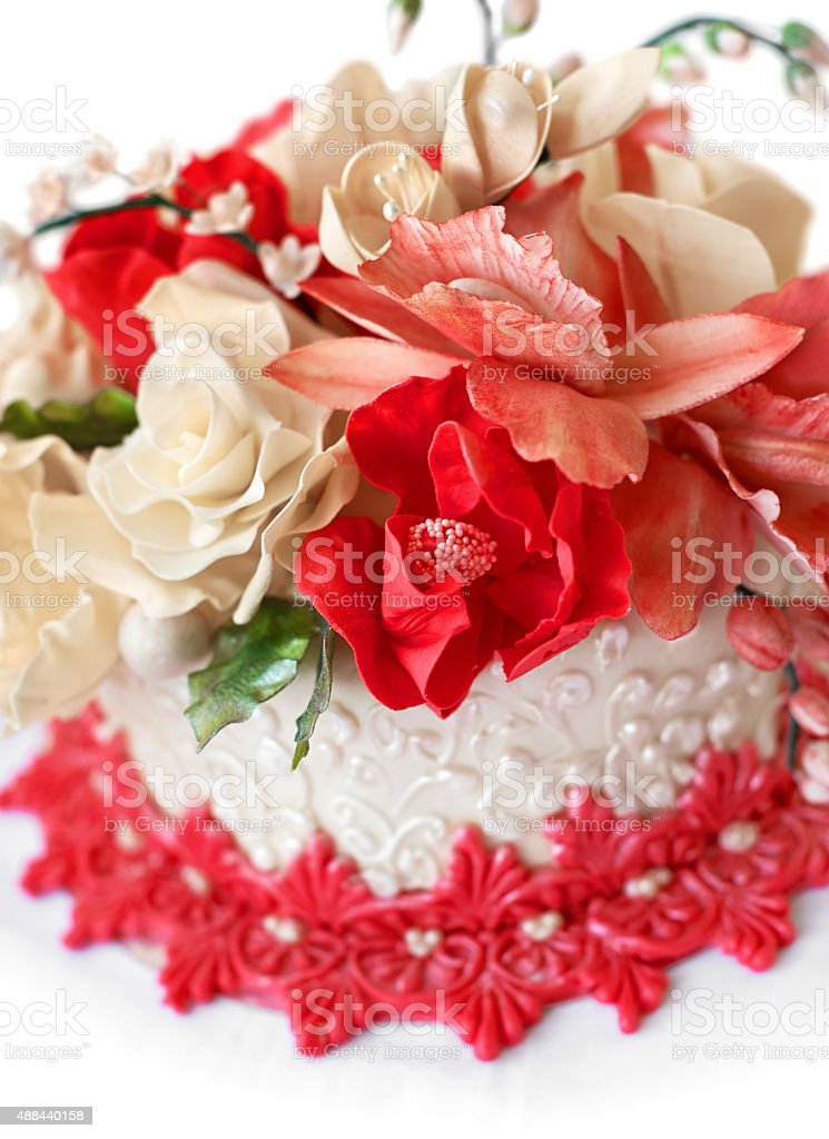Wedding cake with red flowers. stock photo