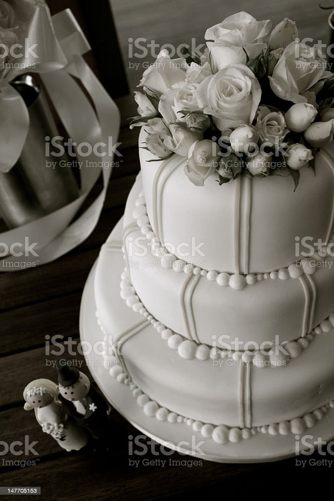 Wedding cake with roses and figurines, mono royalty-free stock photo