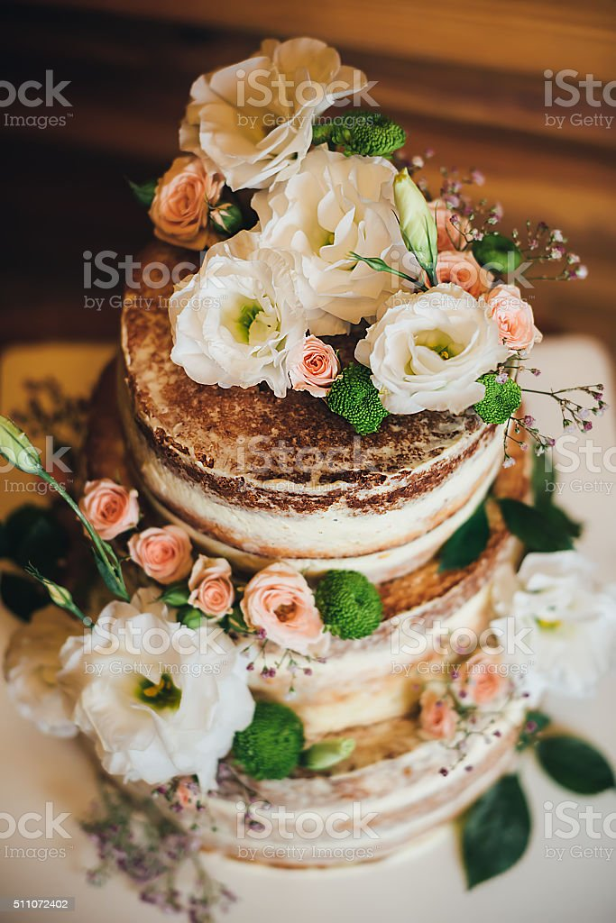 Wedding cake with roses whipped cream stock photo