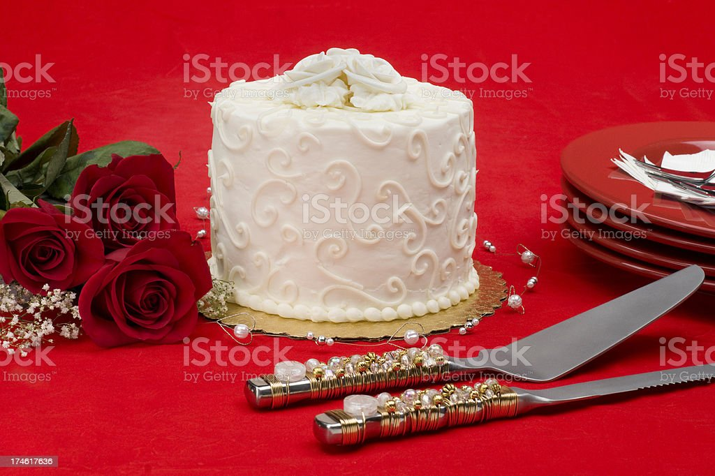 Wedding cake with servers and roses royalty-free stock photo