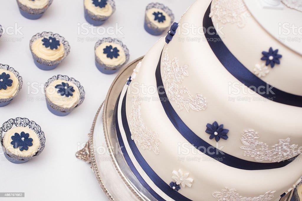 Wedding cakes with cupcakes surrounding stock photo