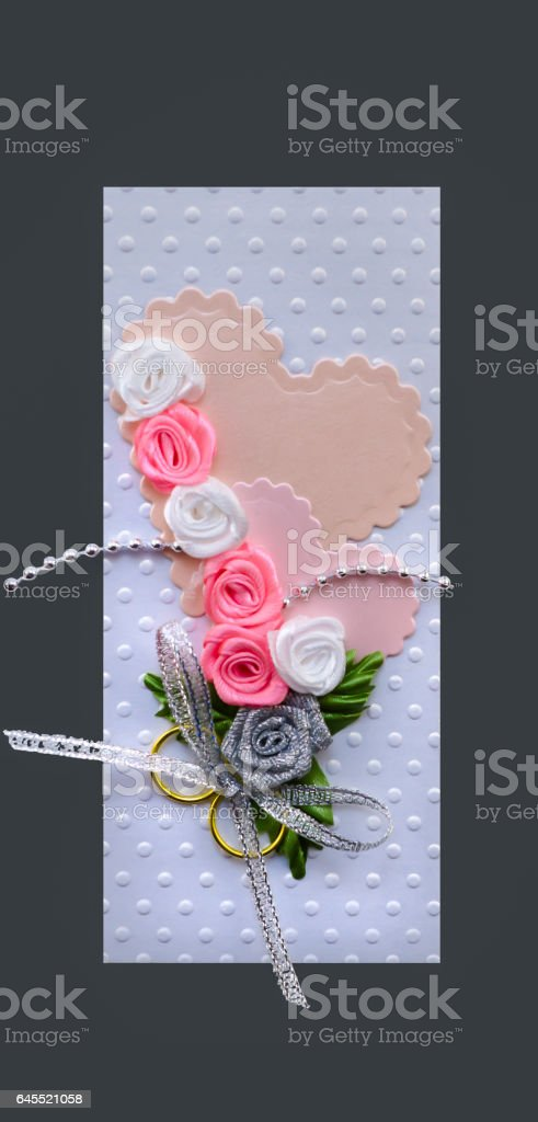 Wedding card handmade with hearts and gold rings stock photo