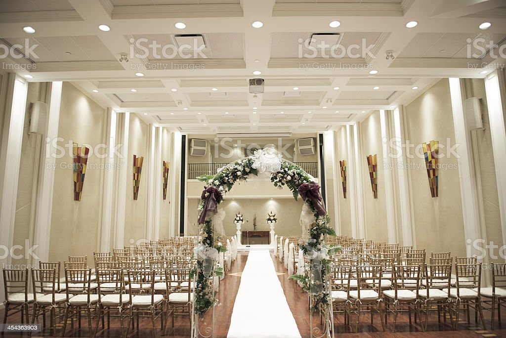 Wedding Ceremony Aisle Indoor With Flower Decoration Stock