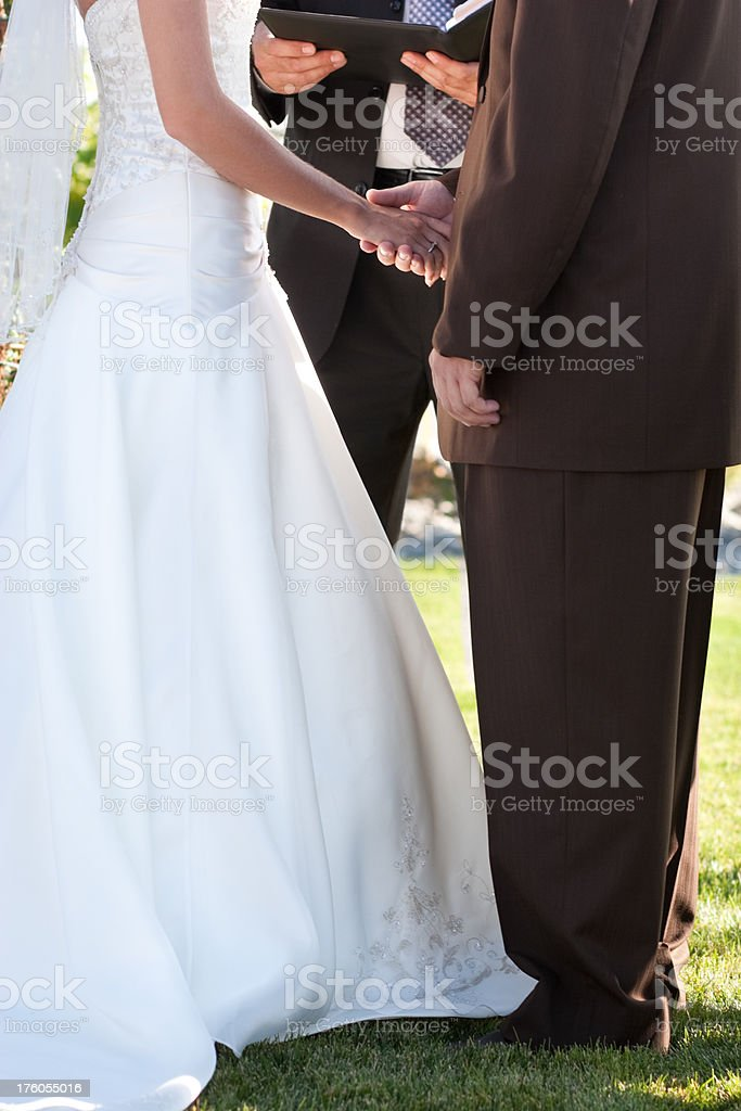 Wedding Ceremony Close Up with Bride and Groom Exchanging Vows royalty-free stock photo