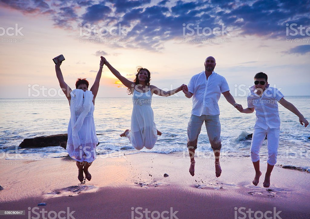 wedding ceremony of mature couple and their family stock photo