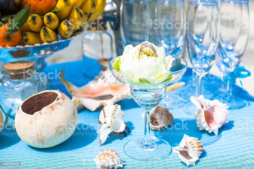 Wedding ceremony on  beach  decorations table with fruit and champagne stock photo