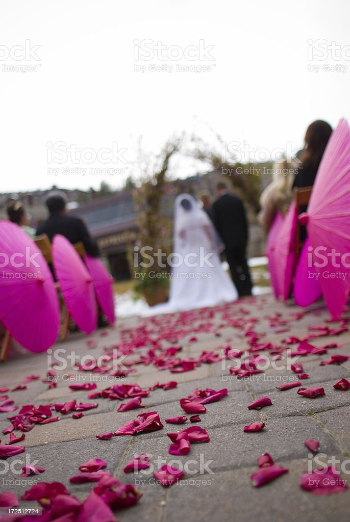 Wedding Ceremony with Pink Flower Petals and Parasols royalty-free stock photo