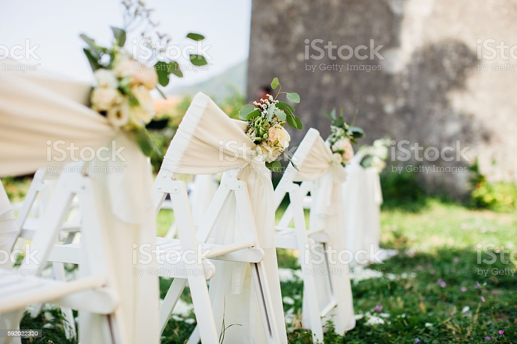 wedding chair cover with flowers decoration stock photo