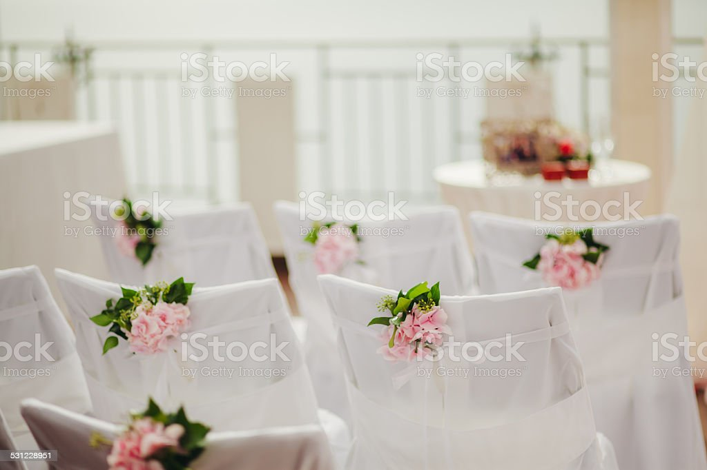 wedding chair covers with pink flowers stock photo