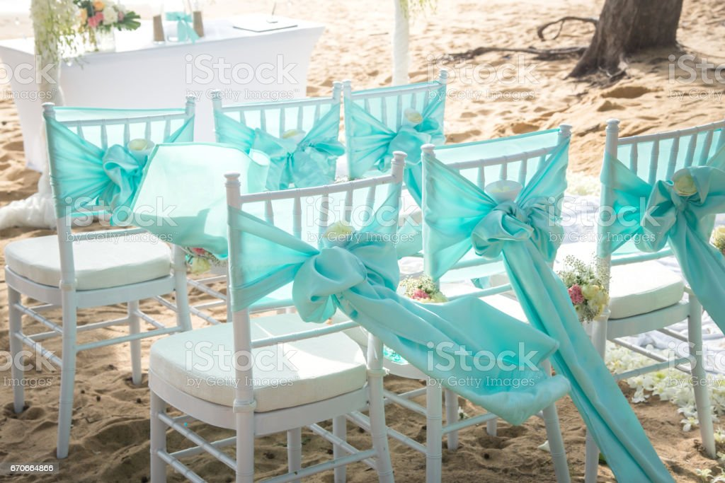 Wedding chair decorated with flowers and stock photo
